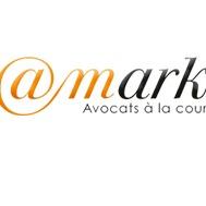 the @Mark logo.