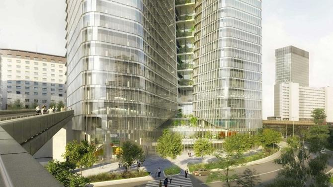 Total doit emménager d'ici à 2022 dans un nouveau siège situé à La Défense. Selon des lettres du préfet d'Île-de-France, Michel Cadot, ce projet est ajourné, tandis que Les Échos évoquent un blocage de l'État.